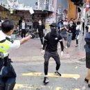 Agents shoot Hong Kong demonstrator
