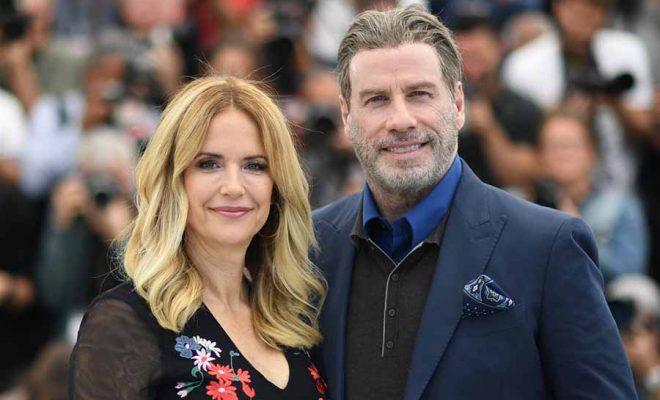 John Travolta with wife