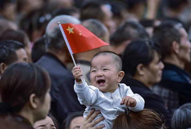 child holding china flag