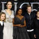 Angelina Jolie surprised by kids